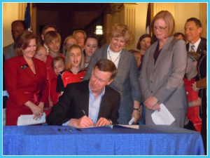 Governor Hickenlooper signs the Jake Snakenberg Youth Sports Concussion Act. Photo by Kenny Hosack.